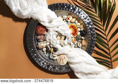 Vintage Steel Metal Tray, Gauze, Sea Shells And Green Palm Leaf Flatly On Beige Background. Summer T