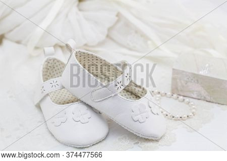 Baptism Booties For A Girl On Lace With Mother Of Pearl Trinket Box And Pearl Bracelet And De-focuse