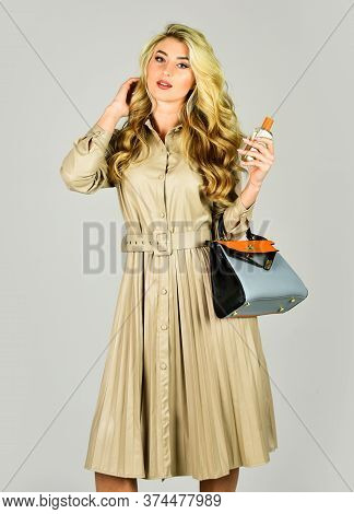 Eau De Toilette. Gorgeous Blond Girl With Curly Hair. Hair Oil Spray. Beauty And Fashion. Shop Assis