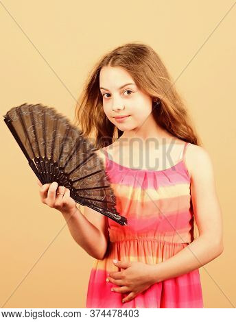 Summer Heat. Fresh Air. Kid Girl Fanning Herself With Fan. Cooling And Ventilation. Conditioning Sys