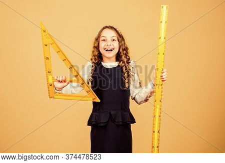 Sizing And Measuring. School Student Study Geometry. Kid School Uniform Hold Ruler. Pupil Cute Girl
