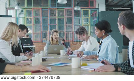 Business Woman Leader Holds Meet Up With Colleagues At A Large Office Table In A Loft Style. Creativ