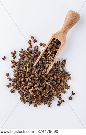 Fragrant Sichuan Pepper On White Acrylic Background
