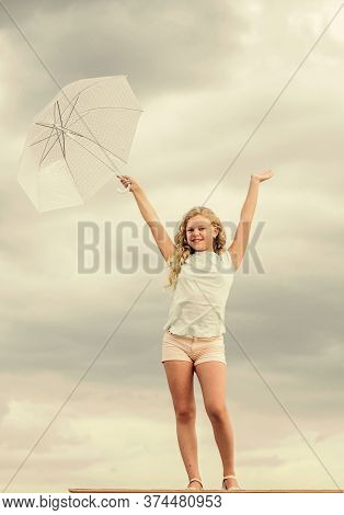 Fresh Air. Girl With Umbrella Cloudy Sky Background. Freedom And Freshness. Happy Childrens Day. Enj