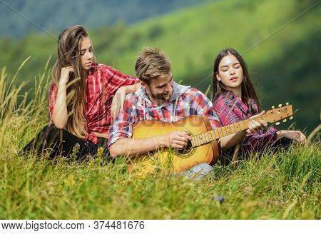 Friends Hiking With Music. Singing Together. Musical Pause. Hiking Entertainment. People Relaxing On