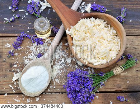 Spoon Full Of Flakes Of Soap With Essential Oil And Bunch Od Lavender Flowers And Sodium Bicarbonate