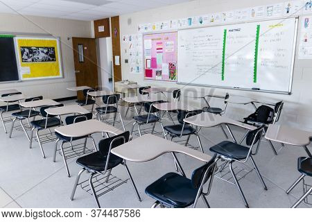 West Islip, New York, Usa - 3 June 2020: A High School Classroom With Empty Desks And No Students Du