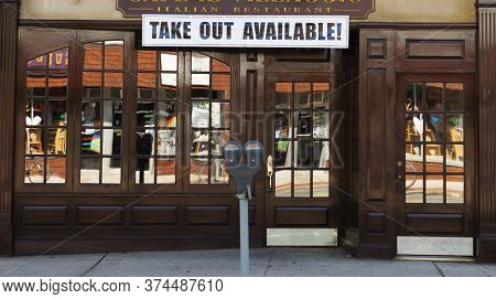 Babylon, New York, Usa - 28 June 2020: An Italian Restaurant Has A Sign That Reads Take Out Availabl