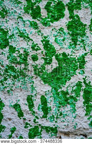 Green Handprints On A Concrete Wall Close Up Isolated.