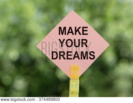Make Your Dreams, Text A Piece Of Paper On Notes On A Green Background. Concept Desire To Keep The S