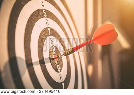 Close Up Red Color Arrow In The Center Of Bullseye Or Bull's-eye For Business Targeting And Good Suc