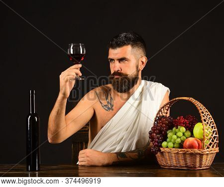 Winemaking And Degustation Concept. God Bacchus With Attentive Face