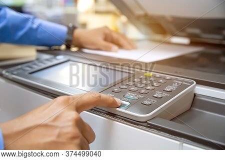 Businessmen Press Button On The Panel For Useing Photocopier Or Printer For Printout And Scanning Do