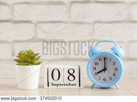 September 8. Wooden Calendar With Date And Table Clock With Bells On The Table Or Shelf. Its Septemb