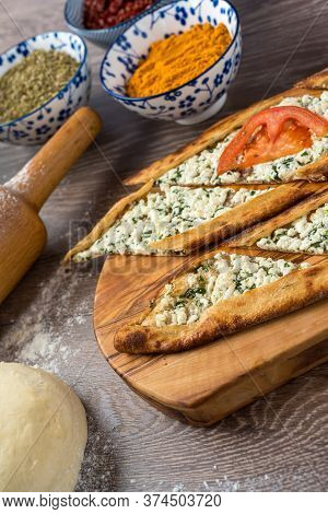 Traditional Turkish Baked Dish Pide. Turkish Pizza Pide, Middle Eastern Appetizers. Turkish Cuisine.