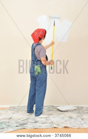 Woman In Overalls Painting Wall