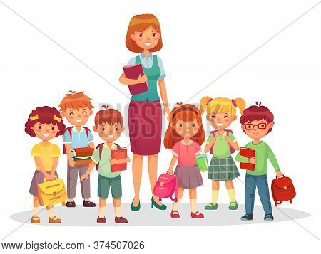 Primary School Kids With Smiling Teacher. Children Learning At School, Education Concept. Woman Tuto