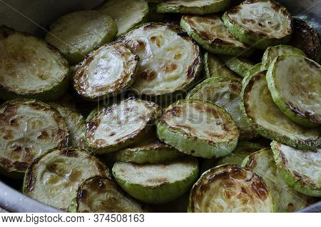 Texture Of Fried Zucchini Slices. Sliced Zucchini Slices Fried In Oil In A Pan. Totally Ready To Eat