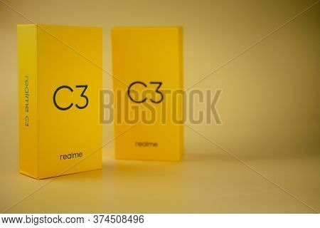 Bangkok, Thailand - July 2, 2020 : Yellow Box Of Realme C3 Entry-level Android Smartphone On Yellow