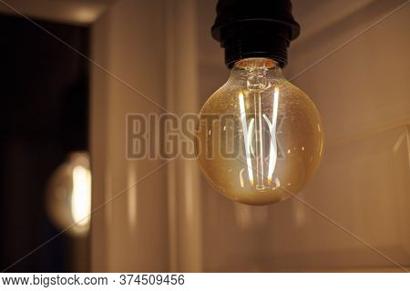Factory Filament Lamp. Vintage Loft Lamp Bulb. Low Light In Industrial Style Area Decorated With Hip