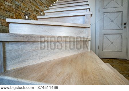 Stylish Wooden Contemporary Staircase Inside Loft House Interior. Modern Hallway With Decorative Lim
