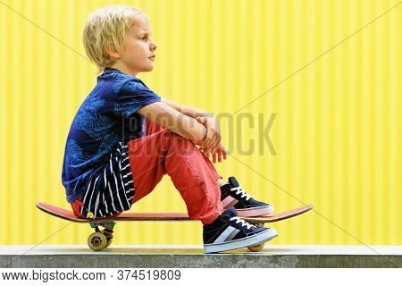 Little Skater With Skateboard Have Fun Before Children Training Class In Skate Park. Active Family L