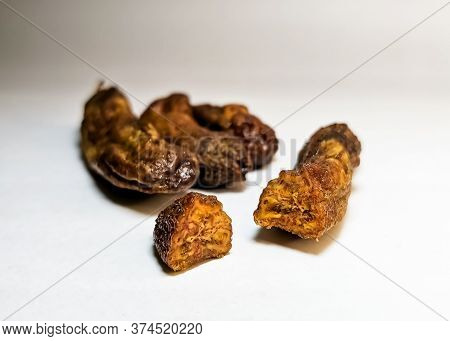 Close-up Of Dried Bananas, Cut Off A Piece Of A Banana On White Background Gradient. Dried Cut Fruit