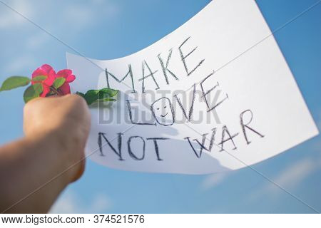 About Anti-racism And Anti-war Protests. Hand Held Banner And Rose Flower. The Text