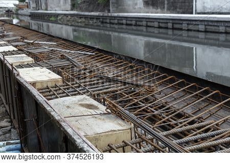 Steel Reinforcing Tie Wire Work At Construction Site Of Embankment For Canal Path And Protecting Riv