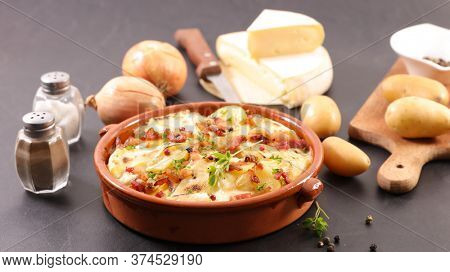 french tartiflette- traditional baked cheese, bacon and potato