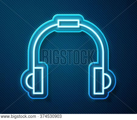 Glowing Neon Line Headphones Icon Isolated On Blue Background. Earphones. Concept For Listening To M