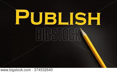 Publish Word Printed In Yellow On Black Paper. Publishing Business Concept
