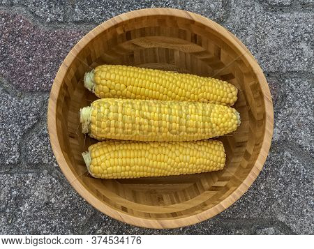 Corns In A Wooden Bowl Close-up Top View. Healthy Eating. Organic Food. Summer Food