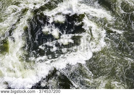 The Surface Texture Of A Stream Of Clear River Water When Viewed From Above. Jets, Foam, Spray, Curr