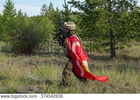Fully Armed American Soldier With Us Marine Corps Flag In The Summer Forest, Active Military Game Ai