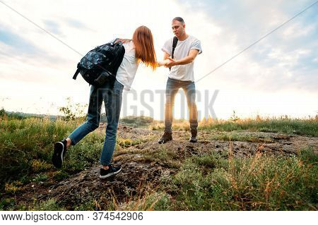Local Travel, Solo Explorers, Small Group Tourist. Young Couple Going For Hiking, Walk In Nature. Su