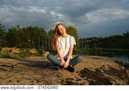 Relaxation, Meditation Mental Health Concept. National Relaxation Day. Red-haired Woman Meditates An