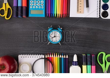 Time For School Concept. Top Above Overhead View Photo Of Clock In Center And Colorful Stationery Ab