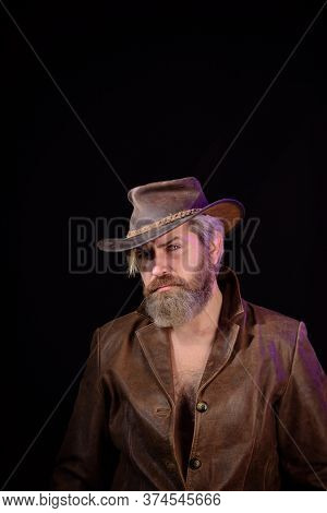 Cowboy Style. Handsome Bearded Man In Cowboy Hat. Sexy Western Man With Hat. Cowboy Wearing Hat. Wes