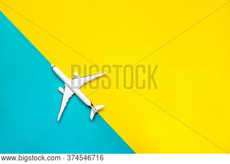 Kids Playing Toys. White Airplane, Aircraft In Top View On Bright Blue And Yellow Backdrop. Flight A