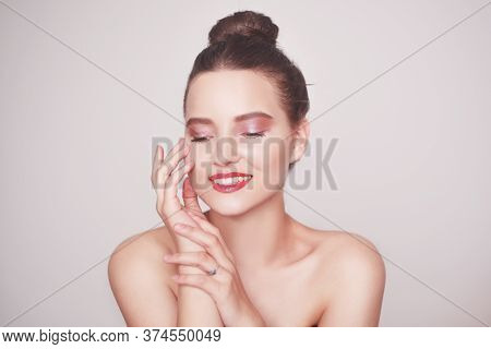 Beautiful Portrait Of A Girl Who Touches Her Skin. Brunette With Delicate Pink Make-up, Perfect Face