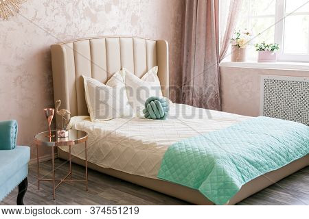 Real Photo Of A Feminine Bedroom Interior With A Comfy Armchair, Bed