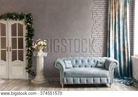 Sofa Chester On A Background Of Gray Wall