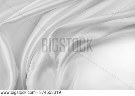 Closeup of rippled white silk fabric lines