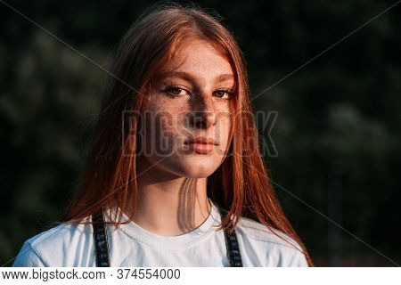 Close-up Portrait Of Young Teen Freckled Ginger Girl