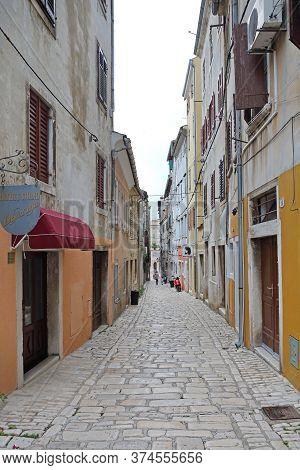 Rovinj, Croatia - October 15, 2014: Narrow Cobblestones Street At Old Town Autumn Day In Rovinj, Cro