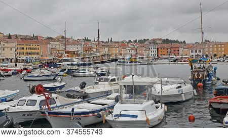 Rovinj, Croatia - October 15, 2014: Boats At Marina Port And Picturesque Colourful Houses In Rovinj,