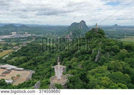 Buddhist Statue Rests Above The Mountain In Ratchaburi Thailand