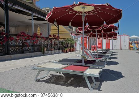 Liguria, Italy - Summer 2020: Empty Beaches For Fear Of The Covid19 Virus. High Quality Photo