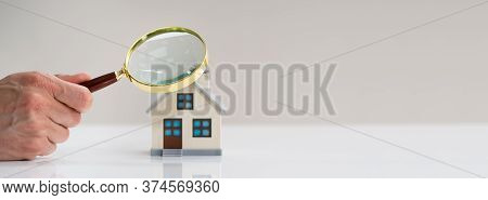 Home Inspection And House Appraisal Using Magnifying Glass